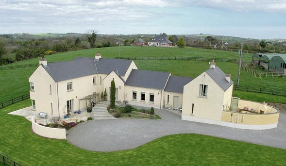 Coolfore Lodge, right, at Monasterboice, Drogheda, Co Louth, is a modern architect-designed house on 9ac of grassland set out in two railed paddocks