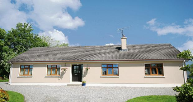 This four bedroom bungalow on 9ac with extensive outhouses at Borleigh, Kilanerin, Gorey, Co Wexford is on the market with a guide