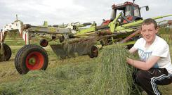 Busy days: Conor Heary turning silage for Richard Smith near Kells, Co Meath Seamus Farrelly