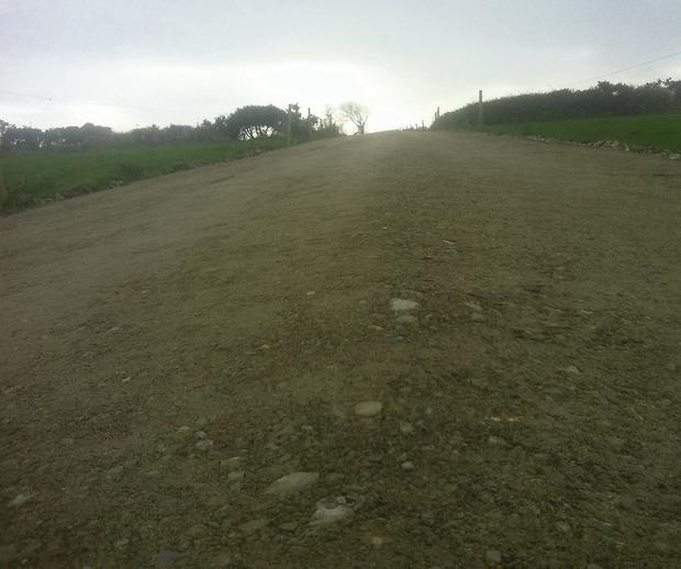 COMPLETE: The finished laneway is smooth and very well compacted/ Note the camber to throw surface water to each side