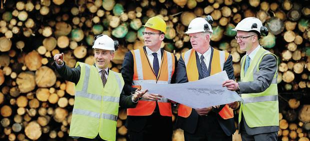 Minister for Agriculture, Simon Coveney pays a visit to SmartPly at Waterford Port Co Kilkenny with (l-r) Gerry Britchfield Acting CEO, Coillte, Coillte chairman John Maloney and Neil Foot of Coillte Panel Products