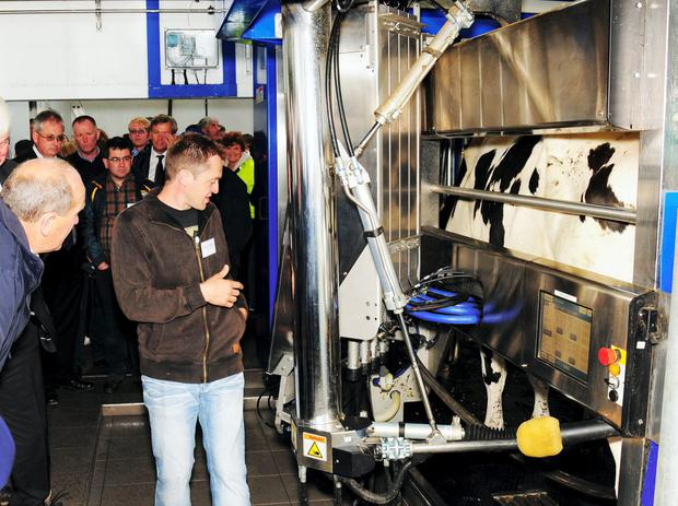 Johnny Hanlon talks about his experience with DeLaval's robotic milking system to the hundreds of farmers that visited his farm in north Kerry last week