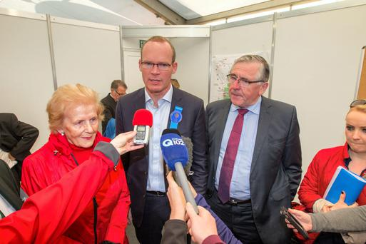 Questions: Minister Coveney with Anna May McHugh, NPA Managing Director, and Junior Minister Tom Hayes at last week's Ploughing.