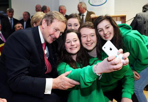 Down with the kids! Taoiseach Enda Kenny poses for a selfie with Foroige members Aoife O'Reilly, Leah McCabe, Darragh McHugh and Ciara Tobin at the official opening of the Virginia Show Centre in Virginia, Co. Cavan on Friday afternoon Photo: Lorraine Teevan.