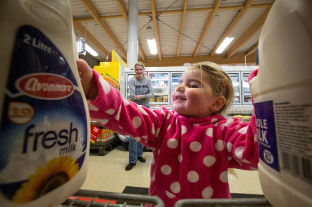 A mother and daughter in Tesco Rush A difficult year ahead has been predicted for milk prices.