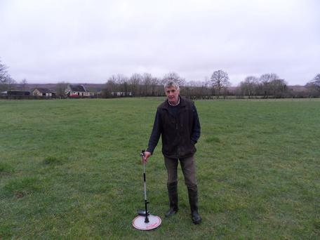 Sean Conway with the plate meter he now uses to measure grass on a weekly basis