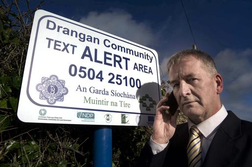 James O'Neill, Muintir na Tíre's regional development officer for the south-east pictured at the launch of Community Text Alert for Dranagan, Co Tipperary, last March. Muintir na Tíre has organised over 600 Community Text Alert areas since the scheme was launched in May 2013. Photo: Joe Kenny