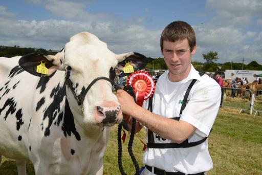 Gerry O'Driscoll from Timoleague with the winner of the West Cork Junior champion friesian