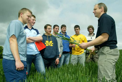 Tim Ashmore, Teagasc (right) with a group of students in a crop of winter wheat.