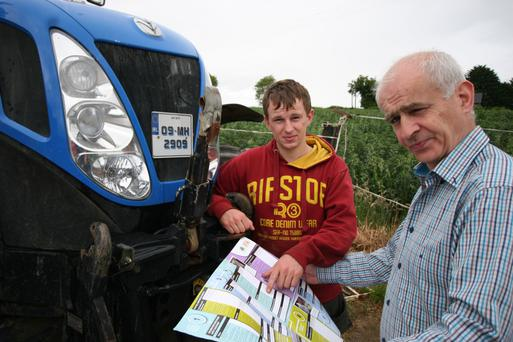 IFA president Eddie Downey pictured with his son Patrick on their farm near Slane. He has urged every farm family to talk through a farm safety statement.