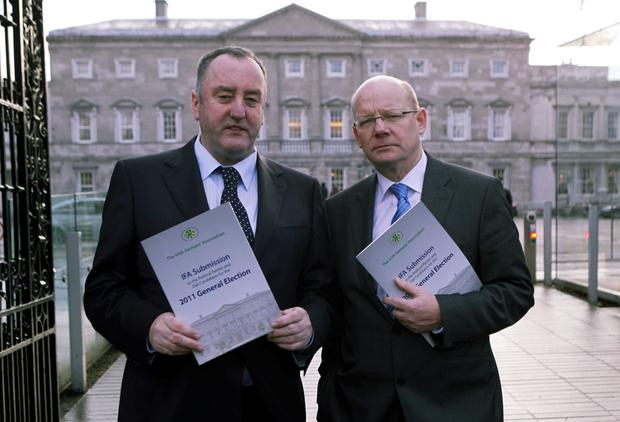 Pat Smith (right) pictured outside Leinster House with former IFA president John Bryan.