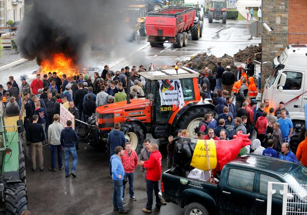 Belgian dairy farmers block access to a milk processing plant in Bethane during a protest at low milk prices. Photo: Reuters