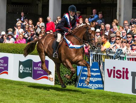 Rosemary Connors on her lap of honour after winning the supreme hunter championship on Woodfield Alight