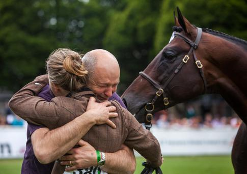 John Varley and his daughter Niamh celebrate after Elusive Emir won the Croker Cup