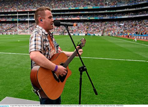 Singer Marty Mone performs 'Hit The Diff' at half-time. GAA Football All-Ireland Senior Championship Quarter-Final, Monaghan v Tyrone at Croke Park. Photo: Stephen McCarthy / Sportsfile