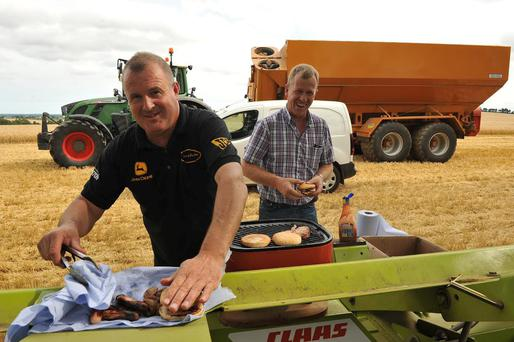 Padraig Furlong and Dan Nolan prepare some food for the harvesting team who were working flat out last week in Clonroche, Co Wexford. Photo: Roger Jones.