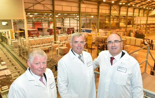 Northern Ireland's Enterprise and Trade Minister Jonathan Bell (centre) with Lakeland's chairman Alo Duffy (left) and CEO Michael Hanley at the opening of the co-op's new €10m logistics centre at Newtownards, Co Down.
