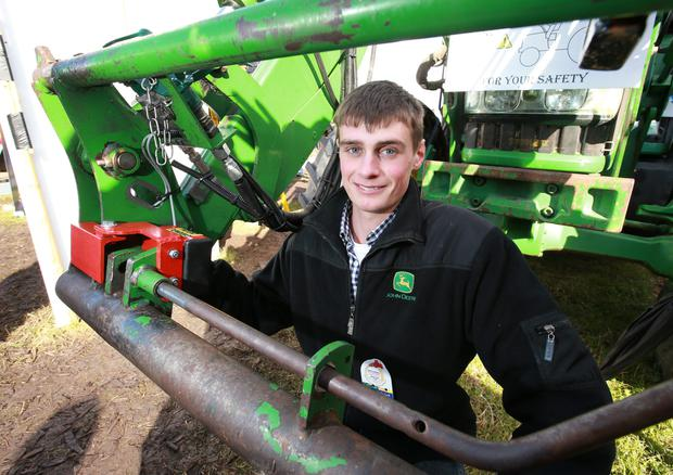 Ian Bolger picture with his Safe Attach anti-crush device for tractors which won the Young Innovation Award at the National Ploughing Championships. Photo: Frank McGrath.