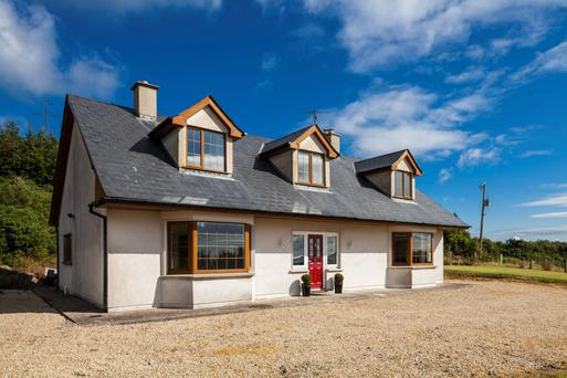 Sunnybank - the modern residence stands on 100 ac of tillage and forestry close to Delgany in Co Wicklow.