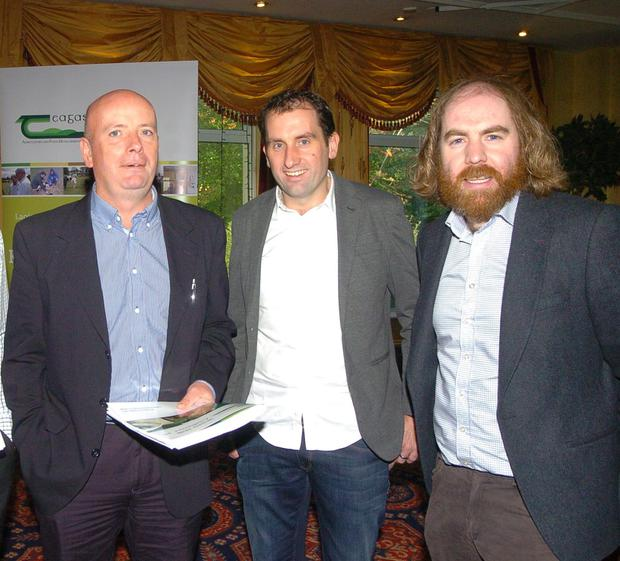 Teagasc advisor Rochie O'Brien, farmer Shane O Loughlan from Monastrevin and Teagasc winter milk specialist Joe Patton at last week's National Milk Conference in Navan. Photo: Seamus Farrelly