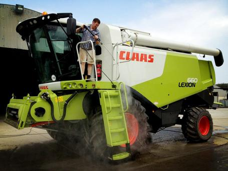 Before parking up the combine for winter take a day to power wash it thoroughly.