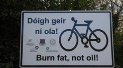 A sign at the roadside on the way in to Clifden promoting cycling for health.