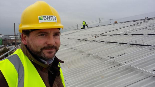 David Maguire on the roof of the new 25,000t grain store built this year by Langmead