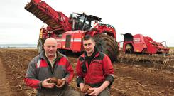 Checking the spuds were Jim Rooney and Gavin Weldon manager of the team of contractors E Finnegan & Sons, Navan, Co Meath harvesting potatoes in Clonmelsh, Co Carlow. The ground conditions were very good. Photo: Roger Jones.