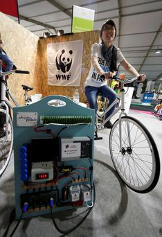 A WWF member cycles to produce power to recharge her phone at the Generation Climate pavilion at the World Climate Change Conference 2015 in Paris. Reuters/Jacky Naegelen
