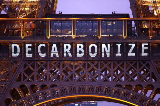 The slogan 'Decarbonize' is projected on the Eiffel Tower as part of the World Climate Change Conference 2015 in Paris. Photo: REUTERS/Charles Platiau