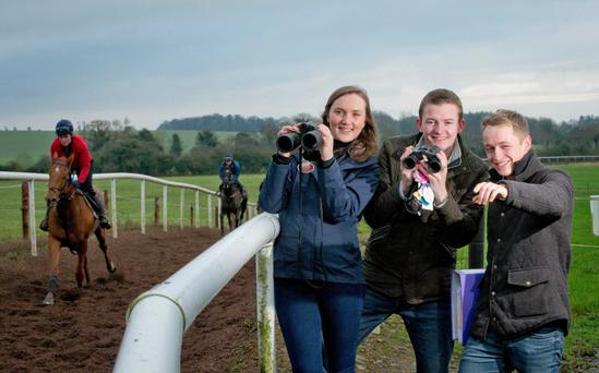 Ashley O'Sullivan (Smurfit Graduate Business School), Mark Hourigan (DIT) and Tarlach Mac Giolla Cheara (UCD) on the gallops at Gordon Elliot's stabes for the launch of the Go Racing Student Society. Photo: Inpho/Morgan Treacy