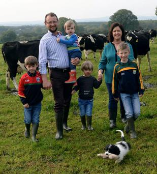 John O'Connor pictured with his wife Rachel and their four boys Owen, Rory, Cathal, Odhran and family pet Rex: John, who farms in Currans, Co Kerry, says broadband access has become an essential tool in his farming life