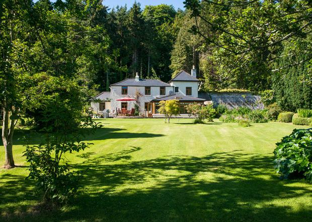 The 35ac residential estate at Tinnahinch includes a period lodge, guest cottage and access to a renowned stretch of river fishing. The property is being guided at close to €4m.