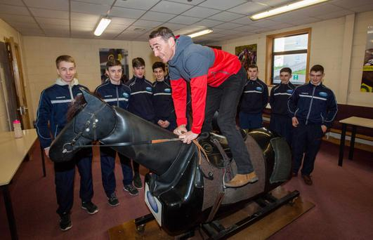Davy Russell giving the trainees some pointers on the simulator during a recent visit to RACE. The Corkman also conducted a training session over hurdles.