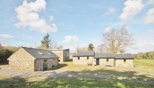 The property at Tuckmills, Co Wicklow has been fully refurbished and the outbuildings include two stone-cut stables.