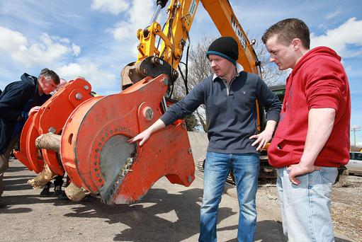 Thomas Moloney pictured speaking to Daniel Loughney from Ballina Co Mayo, about the WoodCracker which he uses to fell trees near rail lines. Photo: Frank McGrath.