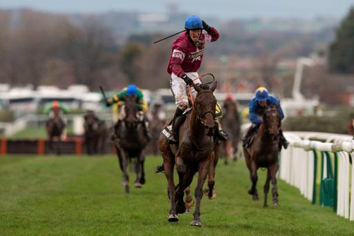 David Duffy celebrates winning the Aintree Grand National on Rule The World.