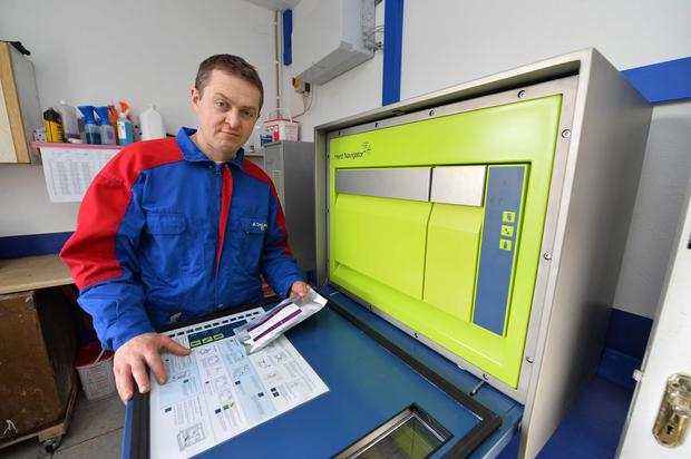 Kerry farmer, Johnny O'Hanlon was the first Irish farmer to install a DeLaval robotic system. He's pictured here working with the Herd Navigator feature which is effectively a mini-lab on the farm giving 24hr advance warning of health issues with individual cows.