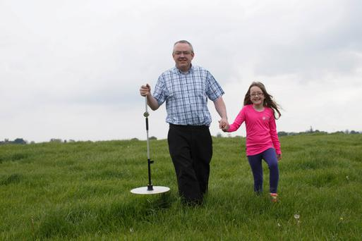 Tim Fitzgerald and his daughter Bronagh do the weekly grass measuring on the family farm at Ballyroan, Co Laois. Photo: Alf Harvey/HR Photos.