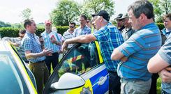 Garda Tom Brosnan, PSV Inpector, Bandon addresses farmers on new standards and road rules for agricultural vehicles at the Dairygold/Teagasc Dairy Development Programme Health & Safety Event on the farm of Dan O'Donovan, Coolmakee, Farnanes, Co Cork. Photo: O'Gorman Photography.