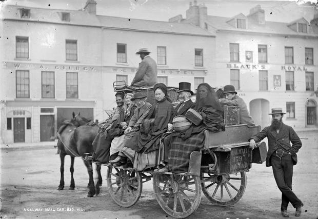 This photograph of a mail car loaded up with passengers near what was then Black's Royal Hotel, Eyre Square in Galway city is believed to have been shot in the early 1880s by Robert French. He was one of the most prolific photographers of this era and his