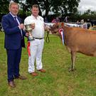 Rob Hancock from Clonakilty receives the cup for Overall Champion Jersey Cow at the Charleville Show from Minister for Agriculture Michael Creed. Photo: Denis Boyle