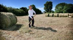 Laurence Lavin tidies up after cutting silage on his farm in Creevagh, Co Sligo. Photo Brian Farrell