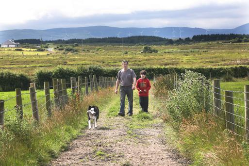 Quentin Harte and his son Darragh on the family farm at Cilleens, Enniscrone. Photo: Brian Farrell