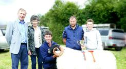 Waterford's Gary Norris with his Scottish Blackface supreme show champion shearling ram at Kilgarvan Agricultural Show, Kerry with the Minister of Agriculture Michael Creed, the judge Patrick Randles, and Margaret and Andrew Norris