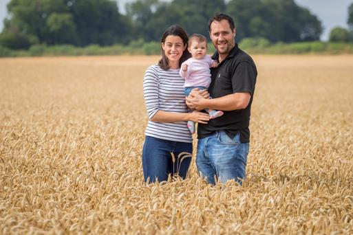 Julian and Valerie Hughes and their baby Robyn on the farm in Kells, Co Kilkenny. Photo: Dylan Vaughan