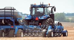 The NH Drive autonomous tractor in action.