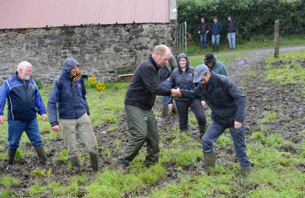 IFA president Joe Healy gets a helping hand from George Anderson on his farm outside Laghey. Mr Healy visited Donegal earlier in September to discuss the weather crisis with local farmers. PHOTO: Clive Wasson