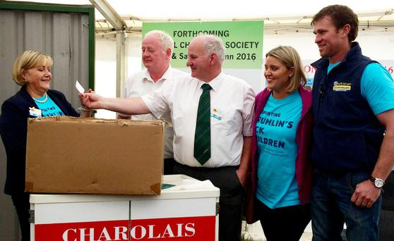 Irish Charolais Cattle Society President, Kevin Maguire drawing the winning ticket for the heifer, with Catherine and Jim Geoghean, and Cora and Eddie Green.