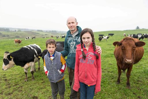 Pat O'Donaghue with his children Cathal and Ashling at home on his Dairy Farm near Ennistymon, Co Clare. Photo: Eamon Ward